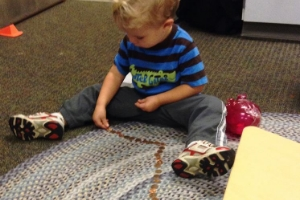 boy sorting pennies